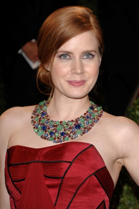 Amy Adams wearing a colorful bib necklace from Fred Leighton, with sapphires, emeralds, rubies and diamonds.